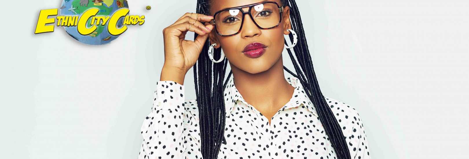 Head and shoulders portrait of fashionable black woman wearing glasses